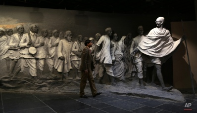 A visitor walks past a mural of Mahatma Gandhi's freedom movement at Dandi Kutir, an exhibition on Mahatma Gandhi, in Gandhinagar, India , Friday, Jan. 9, 2015. The exhibition traces the life and times of Mahatma Gandhi, regarded as the father of the nation, through various phases. (AP Photo/ Ajit Solanki)