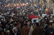 People attend the funeral of a student killed in Tuesday's Taliban attack in Peshawar, Pakistan, Wednesday, Dec. 17, 2014. (AP Photo/Mohammad Sajjad)