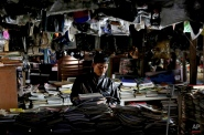 A customer browses through used books and magazines at a flea market on the outskirts of Jakarta, Indonesia, Thursday, Jan. 22, 2015. (AP Photo/Tatan Syuflana)