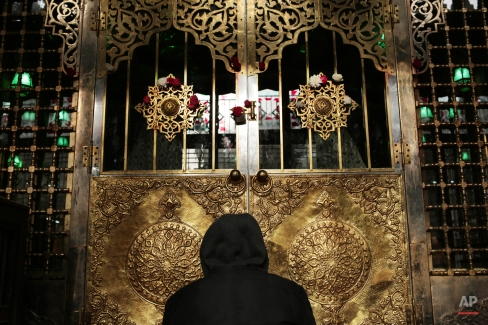 A man prays a day before Moulid, which commemorates the birth of Prophet Muhammad, the central figure of the Islamic religion, at a mosque in Cairo, Egypt, Friday, Jan. 2, 2015. Every year, Egyptians celebrate Moulid by performing ritual dances and prayers and spending time with their families. (AP Photo/Nariman El-Mofty)