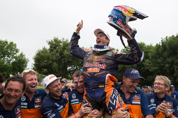 KTM rider Marc Coma of Spain is raised by his crew as he celebrates after winning the Dakar Rally 2015 motorcycle category, at the end of twelfth stage in Buenos Aires, Argentina, Saturday, Jan. 17, 2015. (AP Photo/Felipe Dana)