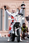 In this Sunday, Jan. 4 photo, Michal Hernik of Poland posses for a picture as he crosses the podium ramp during the symbolic start of the Dakar Rally 2015 in Buenos Aires, Argentina, 2015. According to race authorities Hernik was found dead during the third stage of the race, between the cities of San Juan and Chilecito, in Argentina, Tuesday Jan. 6, 2015. No apparent reason for his death was given by the race organizers. (AP Photo/Natacha Pisarenko)