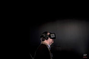 Tristan de Viaris uses an Oculus virtual reality headset in the Nu Reality Desert Home at the Nikon booth at the International CES, Thursday, Jan. 8, 2015, in Las Vegas. (AP Photo/Jae C. Hong)
