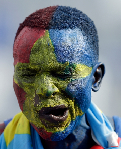 A DR Congo's soccer fan, painted in his national colors, gestures during the African Cup of Nations Group B soccer match between DR Congo and Zambia in Ebebiyin, Equatorial Guinea, Sunday, Jan. 18, 2015. (AP Photo/Themba Hadebe)