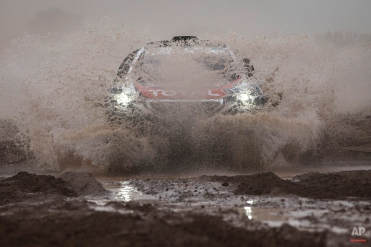 Peugeot driver Stephane Peterhansel and co-pilot Jean Paul Cottret, both of France, race during the third stage of the Dakar Rally 2015 between the cities of San Juan and Chilecito, Argentina, Tuesday, Jan. 6, 2015. (AP Photo/Felipe Dana)