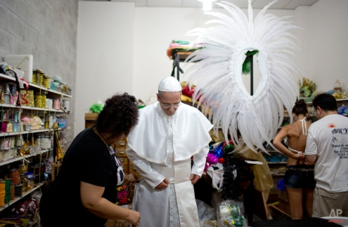 Roman Figun, a local lawyer, gets dressed up to play the role of Pope Francis as the Ara Yevi samba school prepares to put on a carnival parade in Gualeguaychu, Argentina, Saturday, Jan. 10, 2015. (AP Photo/Natacha Pisarenko)