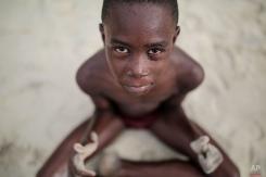 A Zanzibari child poses for the camera after a swim in the Indian Ocean in Zanzibar, Tanzania, on Tuesday, Jan. 20, 2015. (AP Photo/Mosa'ab Elshamy)
