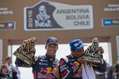 Mini driver Nasser Al-Attiyah of Qatar, right, and co-pilot Matthieu Baumel of France, celebrate on the podium after winning the Dakar Rally 2015 car category in Buenos Aires, Argentina, Saturday, Jan. 17, 2015. (AP Photo/Felipe Dana)