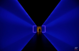 A man walks through a tunnel that connects two buildings of the Museum of Fine Arts, Houston, Tuesday, Jan. 13, 2015, in Houston. The tunnel, titled The Light Inside, is a work by American artist James Turrell. (AP Photo/Pat Sullivan)