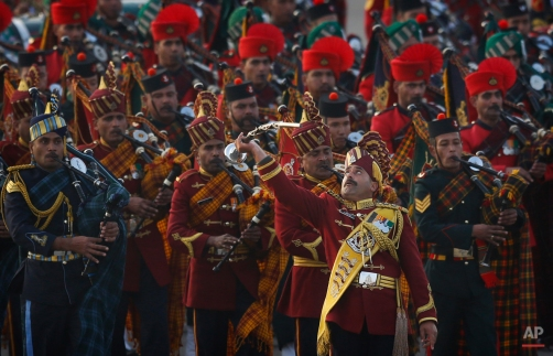 Bands from the three wings of Indian military perform during the Beating Retreat ceremony, in New Delhi, India, Thursday, Jan. 29, 2015. The ceremony marks the end of Republic Day festivities. (AP Photo/Manish Swarup)