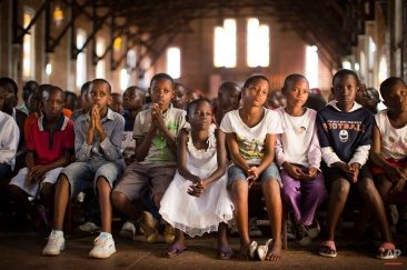 Rwandan children listen and pray during a Sunday morning service at the Saint-Famille Catholic church, the scene of many killings during the 1994 genocide, in the capital Kigali, Rwanda Sunday, April 6, 2014. (AP Photo/Ben Curtis)