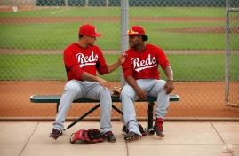Cincinnati Reds' Ismael Guillon, left, and Daniel Corcino get ready for a spring training baseball workout Monday, Feb. 23, 2015, in Goodyear, Ariz. (AP Photo/John Locher)