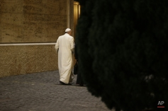 Pope Francis walks alongside Vatican Secretary of State Pietro Parolin, right, as they leave at the end of a special consistory with cardinals and bishops, in the Synod hall at the Vatican, Thursday, Feb. 12, 2015. Pope Francis met with cardinals and bishops who will take part in the upcoming Feb. 14, 2015 consistory during which he will elevate 20 new cardinals. Pope Francis urged his cardinals Thursday to cooperate in reforming the outdated and dysfunctional Vatican bureaucracy, saying the overhaul will help him govern the Catholic Church better and spread the faith more effectively. (AP Photo/Andrew Medichini)