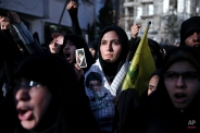 Iranian students chant slogans in front of the Swiss Embassy which represents U.S. interests in Iran, to condemn the killing of three Muslim students in Chapel Hill, North Carolina, during a demonstration in Tehran, Iran, Wednesday, Feb. 18, 2015. (AP Photo/Ebrahim Noroozi)