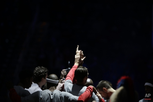 New Orleans Pelicans hold their hands in the air in a huddle before an NBA basketball game against the Atlanta Hawks in New Orleans, Monday, Feb. 2, 2015. (AP Photo/Gerald Herbert)