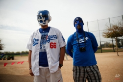 Javier Lopez, left, and Jeff Jayne, watch the Los Angeles Dodgers during the team's first pitchers and catchers workout at spring training, Friday, Feb. 20, 2015, in Phoenix. (AP Photo/John Locher)