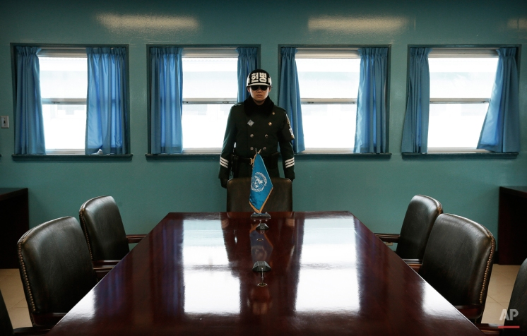 A South Korean army soldier stands at the Military Armistice Committee meeting room at the border village of Panmunjom, which has separated the two Koreas since the Korean War, South Korea Wednesday, Feb. 4, 2015. (AP Photo/Ahn Young-joon)