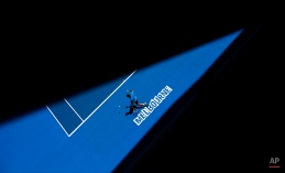 Feliciano Lopez of Spain plays a shot to Jerzy Janowicz of Poland during their third round match at the Australian Open tennis championship in Melbourne, Australia, Saturday, Jan. 24, 2015. (AP Photo/Bernat Armangue)