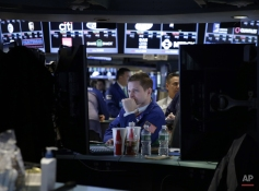 A trader works on the floor of the New York Stock Exchange in New York, Monday, Feb. 9, 2015. U.S. stocks are opening lower, following declines in overseas markets on weak Chinese trade data and more worries about Greece's finances. (AP Photo/Seth Wenig)