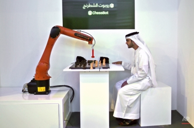 Wafi Dawood, the Chief of Strategy and Excellence of Knowledge and Human Development Authority of the Dubai Government competes with a ChessBot during the second day of the Government Summit in Dubai, United Arab Emirates, Tuesday, Feb. 10, 2015. (AP Photo/Kamran Jebreili)