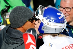 Tiger Woods, left, kisses United States' Lindsey Vonn during the women's giant slalom competition at the alpine skiing world championships on Thursday, Feb. 12, 2015, in Beaver Creek, Colo. (AP Photo/Marco Trovati)