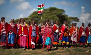 A group of Maasai women arrive to support the young warriors from their village at the annual Maasai Olympics in the Sidai Oleng Wildlife Sanctuary near Mt Kilimanjaro, in southern Kenya Saturday, Dec. 13, 2014. (AP Photo/Ben Curtis)