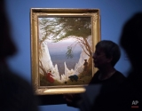 Visitors stand in front of the painting 'White cliffs of Ruegen' (1818) by Caspar David Friedrich during the press preview of the exhibition 'Dahl and Friedrich. Romantic Landscapes' in the Albertinum, a museum of the Dresden State Art Collection (SKD), in Dresden, Germany, Thursday, Feb. 5, 2015. Caspar David Friedrich (1774-1840) and Johan Christian Dahl (1788-1857) are regarded as the leading figures of Nordic landscape painting in the Romantic era. For the first time, the exhibition is directly juxtaposing an extensive selection of around 120 paintings and drawings by both artists and others from the same period and region. The exhibition starts on Feb. 6, 2015 and lasts until May 3, 2015. (AP Photo/Jens Meyer)