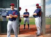 Cleveland Indians' Bryan Shaw, center, and others participate in a spring training baseball practice, Sunday, Feb. 22, 2015, in Goodyear, Ariz. (AP Photo/John Locher)