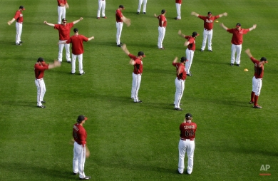 The Arizona Diamondbacks stretch during spring training baseball practice, Sunday, Feb. 22, 2015, in Scottsdale, Ariz. (AP Photo/Darron Cummings)