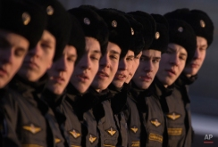 Navy cadets march during a rehearsal for the Victory Day military parade at the Neva River embankment in St.Petersburg, Russia, Wednesday, Feb. 11, 2015. Victory Day, marking the 70th anniversary of the defeat of Nazi Germany, Russia's most important secular holiday will be celebrated on May 9. (AP Photo/Dmitry Lovetsky)