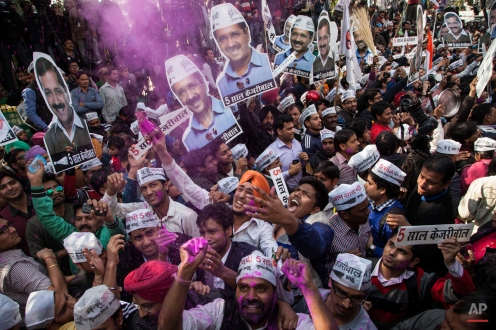 Supporters of the Aam Aadmi Party, or Common Manís Party, celebrate their party's victory in New Delhi, India, Tuesday, Feb. 10, 2015. The upstart anti-corruption party has won a smashing victory in elections to install a state government in India's capital, officials said Tuesday, dealing a huge blow to Prime Minister Narendra Modi's Hindu nationalist party. (AP Photo/Tsering Topgyal)