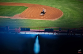 A member of the grounds crew grooms the infield of Space Coast Stadium, the spring training home of the Washington Nationals baseball team, Wednesday, Feb. 18, 2015, in Viera, Fla. (AP Photo/David Goldman)