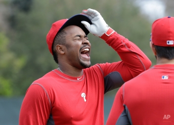 Philadelphia Phillies infielder Chris Nelson, left, laughs during a spring training baseball workout, Tuesday, Feb. 17, 2015, in Clearwater, Fla. (AP Photo/Lynne Sladky)