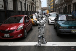Street artist Julian Lopez dressed as a robot performs for tips at a traffic light in Lima, Peru, Friday, Feb. 13, 2015. (AP Photo/Martin Mejia)