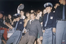 Police hold back London fans of the Beatles, 1964. (AP Photo)