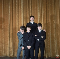 """The Beatles are shown on the set of the """"Ed Sullivan Show"""" in New York, Feb. 8, 1964. In back is John Lennon; the others, from left to right, are: George Harrison, Ringo Starr and Paul McCartney. (AP Photo)"""