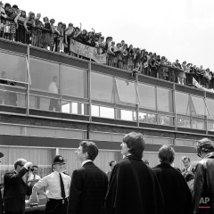 Fans-about 100 of them, welcome the Beatles at London Airport, in England, on July 2, 1964, when the pop group arrived after a tour of Australia and New Zealand. From right, three of the group are John Lennon, Ringo Starr, and George Harrison, Paul McCartney, the fourth member, is not seen. (AP Photo)