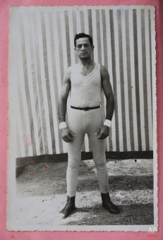 In this Feb. 7, 2015 photo, a photograph of Ricardo Farfan shows him as a performer in 1954 at his father's circus, the Farfan Brothers Circus, in Peru. (AP Photo/Esteban Felix)