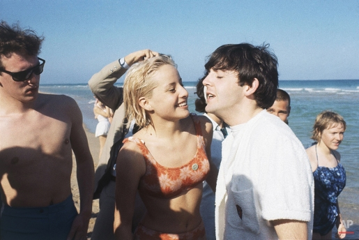 Paul McCartney of the Beatles, right, at a beach in Miami, Florida in February 1964. Others are unidentified. (AP Photo)