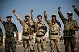 Houthi Shiite Yemenis wearing army uniforms chant slogans during a rally to show support for their comrades in Sanaa, Yemen, Wednesday, Feb. 4, 2015. (AP Photo/Hani Mohammed)