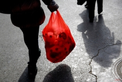 A woman carries a plastic bag loaded with sheep toys as she leaves a wholesale market in Beijing, Thursday, Feb. 12, 2015. Chinese will celebrate the Lunar New Year on Feb. 19 this year which marks the Year of Sheep on the Chinese zodiac. (AP Photo/Andy Wong)