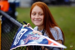 Detroit Tigers fan Bryana Wright of Lakeland, Fla., waits for autographs after a spring training baseball workout in Lakeland, Fla., Tuesday, Feb. 24, 2015. (AP Photo/Gene J. Puskar)