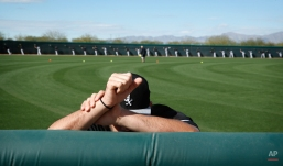 Chicago White Sox's Zach Phillips warms up before a spring training baseball workout, Tuesday, Feb. 24, 2015, in Phoenix. (AP Photo/John Locher)