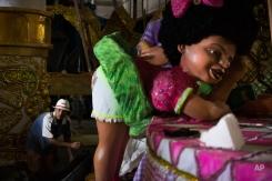 A man works on a carnival float at the Mangueira Samba school in Rio de Janeiro, Brazil, Tuesday, Feb. 3, 2015. Brazil has begun preparing for its pre-Lenten world famous festival that starts on Feb. 13. (AP Photo/Felipe Dana)