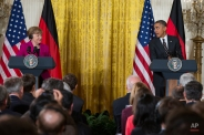 German Chancellor Angela Merkel listens as President Barack Obama speaks during their joint news conference in the East Room of the White House in Washington, Monday, Feb. 9, 2015. The leaders were expected to discuss the ongoing conflict in Ukraine, and arming Ukrainian fighters to wage a more effective battle against Russian-backed separatists. (AP Photo/Evan Vucci)