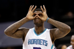 Charlotte Hornets' Marvin Williams gestures after making a 3-point basket against the Washington Wizards during the second half of an NBA basketball game in Charlotte, N.C., Thursday, Feb. 5, 2015. (AP Photo/Chuck Burton)