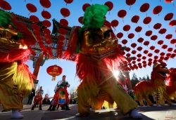 Chinese perform lion dance during the opening of Ditan Temple Fair on the Lunar New Year's Eve in Beijing, China, Wednesday, Feb. 18, 2015. According to the Lunar calendar, Chinese will celebrate the Year of the Sheep on Feb. 19. (AP Photo/Andy Wong)