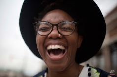 Tori Sisson laughs with excitement and wedding day jitters just before marrying Shante Wolfe, Monday, Feb. 9, 2015, in Montgomery, Ala. Alabama is the 37th state to allow same-sex marriage. (AP Photo/Brynn Anderson)