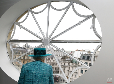 Britain's Queen Elizabeth II looks at the view out of a window, during a visit to reopen Canada House, following an extensive programme of restoration and refurbishment, in London, Thursday, Feb. 19, 2015. Canada House is the official home to the Canadian High Commission in the United Kingdom. The building was first opened in 1925 by King George V. (AP Photo/Kirsty Wigglesworth)