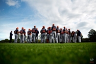 Members of the Houston Astros gather on a practice field before a spring training baseball workout, Saturday, Feb. 21, 2015, in Kissimmee, Fla. (AP Photo/David Goldman)
